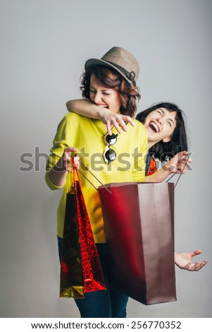 two women fight for purchase - stock photo