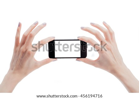 Two women hands holding a smart phone in horizontal position to take a photo isolated on white
