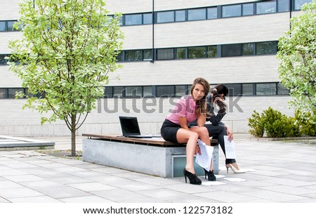 Two women have a rest in city park - stock photo