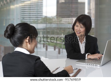 Two women having a business meeting - stock photo