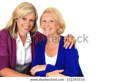 Two women hugging, studio isolated on white.  - stock photo