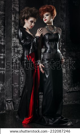 Two women in fetish costumes - stock photo