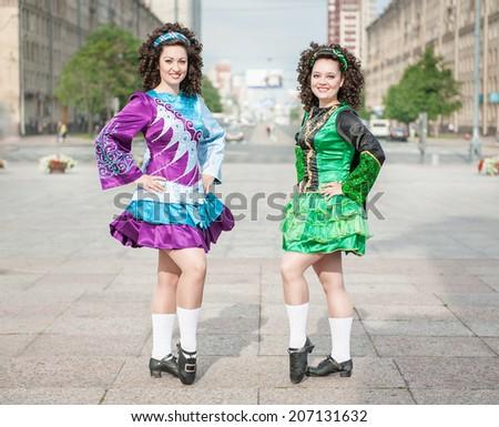 Two women in irish dance dresses posing  - stock photo
