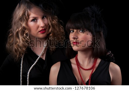 Two women in retro style on a black background
