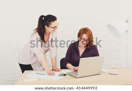 Two women in the office. Teamwork, colleagues, business communication. Working process. Middle-aged architects designers in team work discuss project. Start up discussion. Corporate female coworkers.  - stock photo