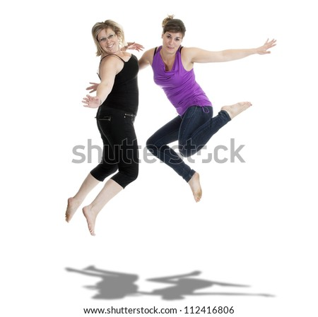 two women jumping in the air. On white background - stock photo