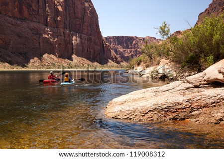Two Women Kayaking the Colorado River (in Glen Canyon) - stock photo