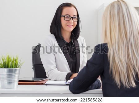 Two women meeting in the office - stock photo