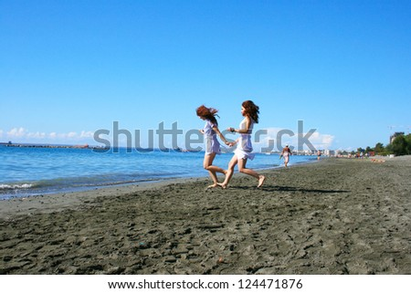 Two women on beach in Limassol, Cyprus. - stock photo