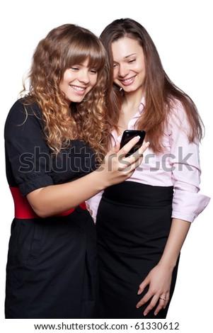 Two women posing on white background - stock photo