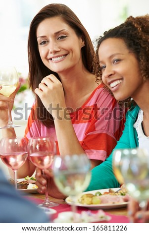Two Women Relaxing At Dinner Party - stock photo