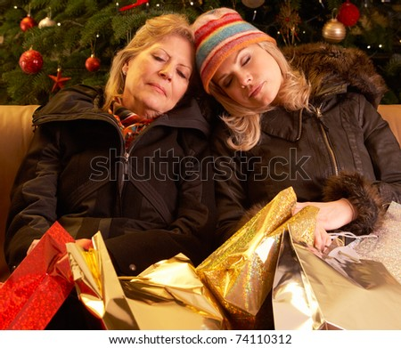 Two Women Returning After Christmas Shopping Trip - stock photo