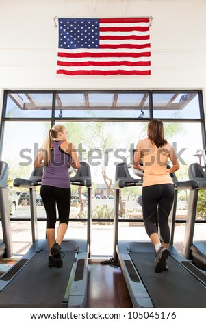 Two Women Running on a Treadmill