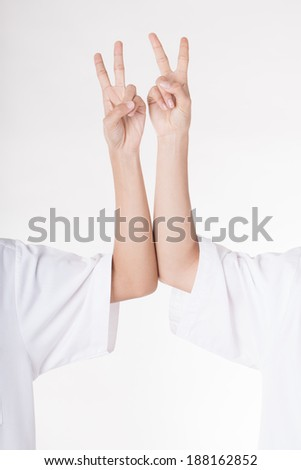 Two women's hand with two fingers up isolated on white background  - stock photo