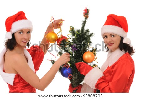 Two women santa decorate a christmas tree isolated on white background