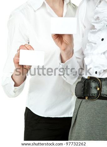 Two women showing blank badges, you can write your text on them; female hands holding badges - stock photo