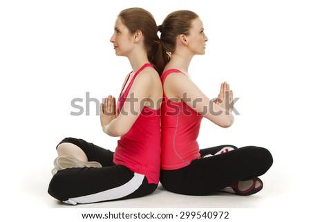 two women back to back stockbilder und bilder und
