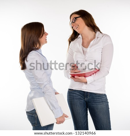 two women talk about business