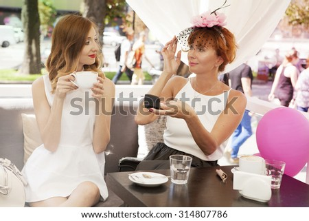 Two women talking in the cafe - stock photo