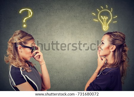 Two women thinking one has a question another solution with light bulb above head isolated on gray background.