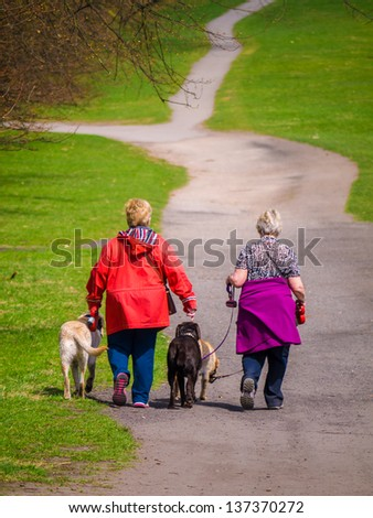 Two women walking dogs