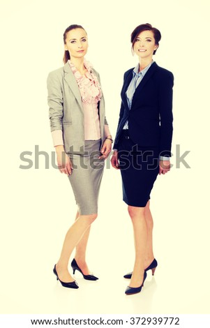 Two women wearing office outfits. - stock photo