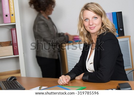 Two women working together in  a modern office