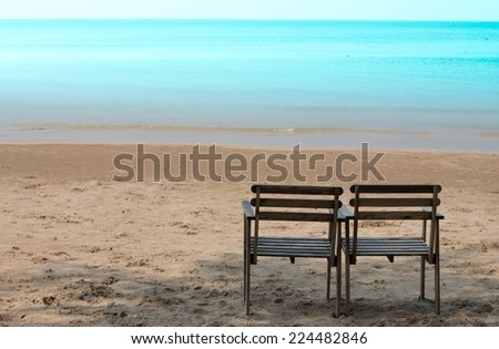 Two wood chair on the beach - stock photo
