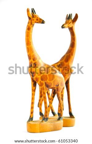 Two Wood Giraffes on white background - stock photo