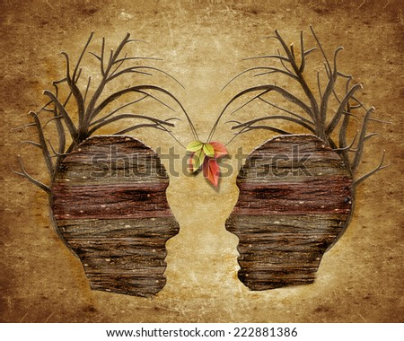 two wood human head and leaves  - stock photo