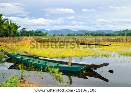 Two wooden boats are anchored, golden hours on the Lak lake, Dak Lak province, Vietnam - stock photo
