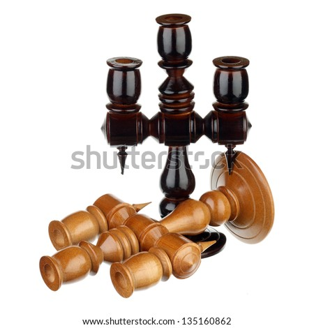 Two wooden candlesticks over white background