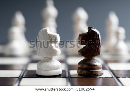 two wooden chess horses - stock photo