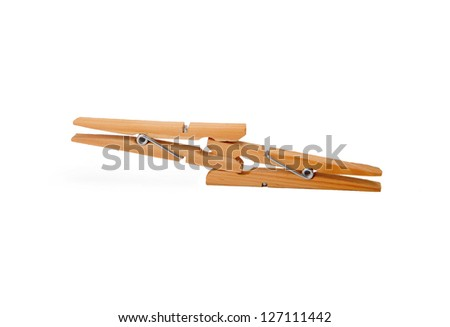 Two wooden clothespin isolated on white background