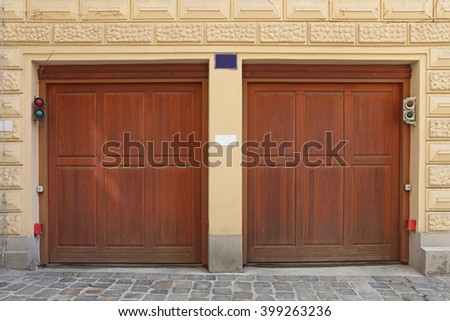 Two Wooden Garage Doors at House