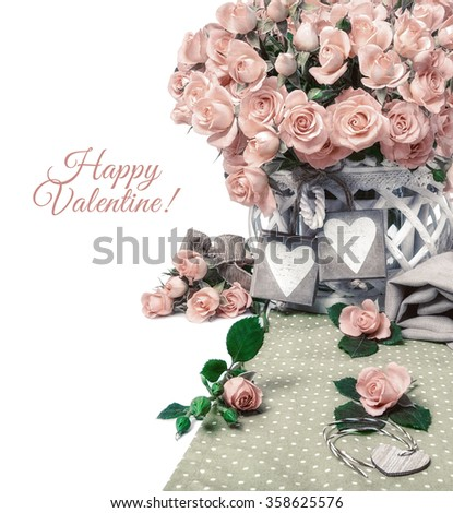Two wooden heart tags among beautiful pink roses on white. Space for your text on the right. Border element for design for a special occasion: Anniversary, Mothers day or Valentine. Image is toned. - stock photo