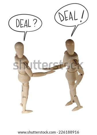 Two wooden mannequin in shaking hand pose saying deal isolated on white - stock photo