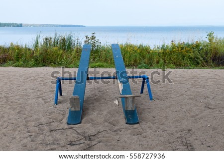 Two wooden seesaws on a playground