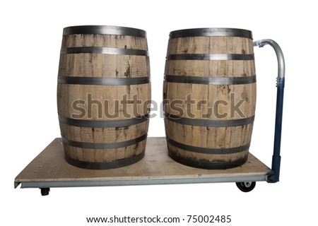 Two wooden whiskey barrels on a cart isolated on white