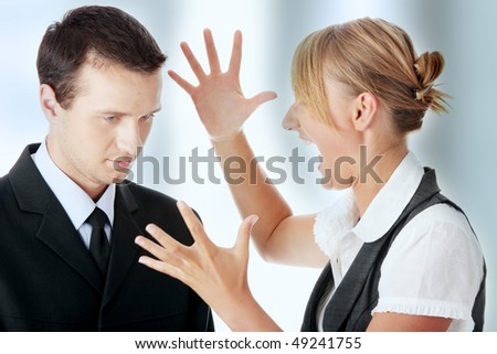 Two work colleagues arguing (male and female) - stock photo