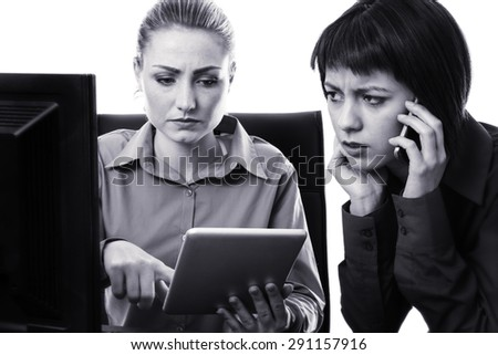 two work colleagues working together in the office looking like something is wrong  - stock photo
