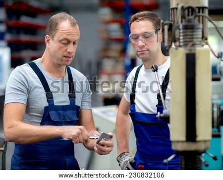 two worker on the machine - stock photo