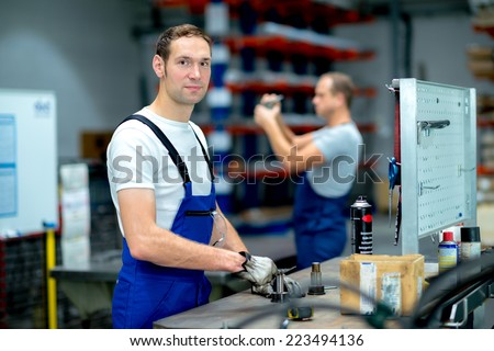 two worker on workbench - stock photo