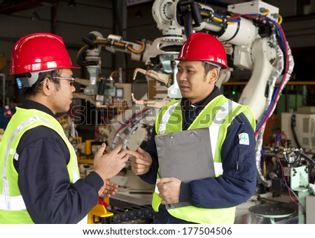 Two workers discussion in factory