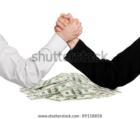 Two wrestling hands and money isolated on white background - stock photo