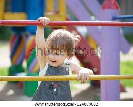 two-year child at playground area in summer - stock photo