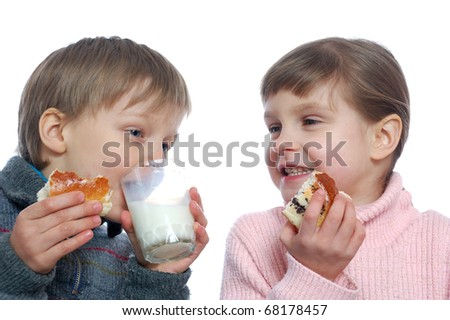 two 5 year old kids eating and drinking milk