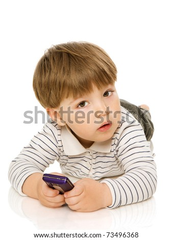 Two years boy smiling sitting on floor isolated on white - stock photo