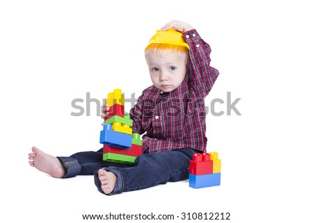 Two years old boy playing with cubes