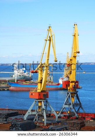 Two yellow lifting cranes
